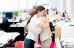 Coworkers Hugging --- Image by © MM Productions/Corbis